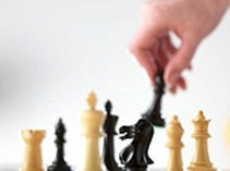 chess pieces with hand